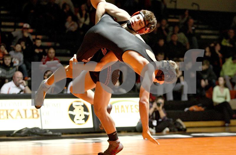 Monica Maschak - mmaschak@shawmedia.com<br /> DeKalb's Matt Macarus takes Sycamore's Michael Ernster to the mat in the 152-pound match at DeKalb High School on Thursday, January 16, 2014. Macarus won the match, 14-5. DeKalb won the meet, 51-8.