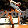 Monica Maschak - mmaschak@shawmedia.com<br /> DeKalb's Matt Macarus takes Sycamore's Michael Ernster to the mat in the 152-pound match at DeKalb High School on Thursday, January 16, 2014. Macarus won the match, 14-5. DeKalb won the meet, 51-8.