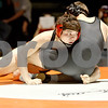 Monica Maschak - mmaschak@shawmedia.com<br /> DeKalb's Matt Macarus looks to his coaches as he wrestles Sycamore's Michael Ernster in the 152-pound match at DeKalb High School on Thursday, January 16, 2014. Macarus won the match, 14-5. DeKalb won the meet, 51-8.