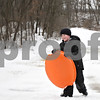 Monica Maschak - mmaschak@shawmedia.com<br /> Aden Schultz, 6, climbs up the sledding hill only to sled back down at the Russell Woods Forest Preserve in Genoa on Saturday, January 11, 2014.