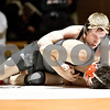 Monica Maschak - mmaschak@shawmedia.com<br /> DeKalb's Brad Green takes down Sycamore's Jesus Renteria in the 138-pound match at DeKalb High School on Thursday, January 16, 2014. Green won the match by a technical knockout. DeKalb won the meet, 51-8.