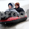Monica Maschak - mmaschak@shawmedia.com<br /> Brothers Maverick Warren (left), 9, and Cooper Warren, 7, ride their tube down an icy section of the hill at the Russell Woods Forest Preserve in Genoa on Saturday, January 11, 2014.