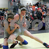 Monica Maschak - mmaschak@shawmedia.com<br /> Cary Grove's Sean Cullen (right) wrestles with Kaneland's Matthew Reman in the 126-pound fifth-place match at Saturday's Sycamore Invitational. Cullen won, 3-0.