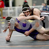 Monica Maschak - mmaschak@shawmedia.com<br /> Marengo's Matt Pandocchi (red) throws Hampshire's Anton Krocko to the mat in the 182-pound third-place match at Saturday's Sycamore Invitational. Pandocchi won, 8-2.
