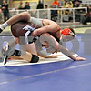 Monica Maschak - mmaschak@shawmedia.com<br /> McHenry's Cam Pait (gray) wrestles against Marengo's Gary Wagley in the 160-pound third-place match at Saturday's Sycamore Invitational. Pait won, 9-0.