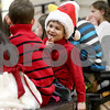 Monica Maschak - mmaschak@shawmedia.com<br /> Grant Davids whispers with a friend before Hiawatha Elementary's kindergarten through second grade Winter Music Program on Wednesday, January 15, 2014.
