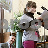 Rob Winner – rwinner@shawmedia.com<br /> <br /> Jefferson Elementary School student Emily Overton, 5, gets a chuckle from the audience while speaking at the DeKalb Public Library on Monday, Jan. 13, 2014. Secretary of State Jesse White (left) presented the library an $11.6 million grant check for the library expansion.