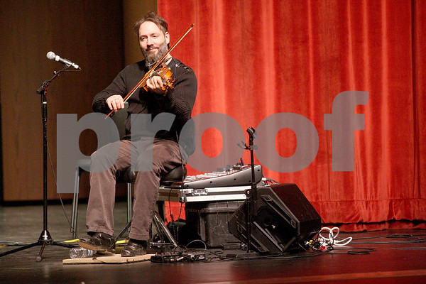 Monica Maschak - mmaschak@shawmedia.com<br /> Olivier Demers, from French-Canadian folk group Le Vent du Nord, plays his violin and uses his feet as the percussion at DeKalb High School on Tuesday, January 14, 2014. A public concert will be held at the high school this Saturday at 7 p.m.