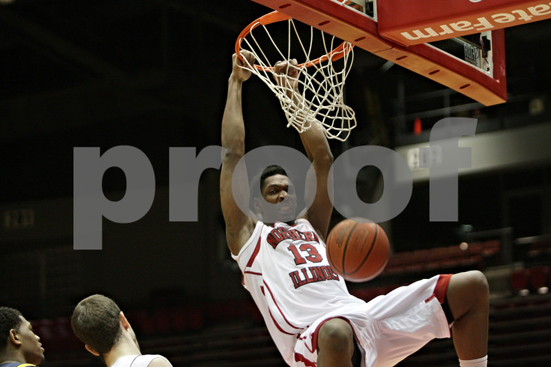 Rob Winner – rwinner@shawmedia.com<br /> <br /> Northern Illinois forward Kevin Gray dunks for two points in the first half of a game against Kent State at the Convocation Center in DeKalb, Ill., Wednesday, Jan. 15, 2014.