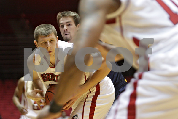 Rob Winner – rwinner@shawmedia.com<br /> <br /> Northern Illinois center Jordan Threloff (left) is pressured from behind by Kent State's Mark Henniger to force a jump ball during the first half of their game at the Convocation Center in DeKalb, Ill., Wednesday, Jan. 15, 2014.