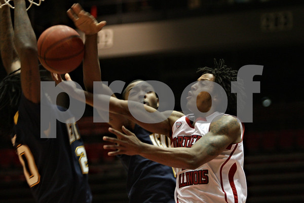 Rob Winner – rwinner@shawmedia.com<br /> <br /> Northern Illinois guard Daveon Balls (right) tries to take a shot as Kent State's Khaliq Spicer gets a hand on the ball during the first half of their game at the Convocation Center in DeKalb, Ill., Wednesday, Jan. 15, 2014.