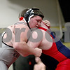 Monica Maschak - mmaschak@shawmedia.com<br /> Kaneland's Justin Diddell (gray) wrestles against Belvidere North's Jake Rodgers in the 285-pound  fifth-place match at Saturday's Sycamore Invitational. Diddell won, 1-0.