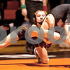Monica Maschak - mmaschak@shawmedia.com<br /> DeKalb's Parker Stratton (left) wrestles Sycamore's Kyle Akins in the 126-pound match at DeKalb High School on Thursday, January 16, 2014. Akins won the match, 8-1. DeKalb won the meet, 51-8.