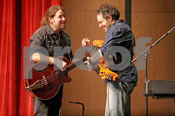 Monica Maschak - mmaschak@shawmedia.com<br /> Le Vent du Nord's Rejean Brunet, on the bass, and Nicolas Boulerice, on the hurdy gurdy, play a song at DeKalb High School on Tuesday, January 14, 2014. The French-Canadian folk group will hold a public concert at the high school this Saturday at 7 p.m.