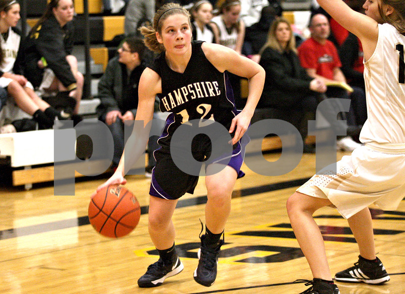 Monica Maschak - mmaschak@shawmedia.com<br /> Hampshire's Nikki Dumoulin dribbles closer to the hoop in the third quarter against Sycamore at Sycamore High School on Tuesday, January 14, 2014. Hampshire lost, 47-29.