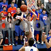 Monica Maschak - mmaschak@shawmedia.com<br /> Genoa-Kingston's Ian Fell takes it to the hoop in the first quarter against Rockford Christian on Tuesday, January 21, 2014. The Cogs won, 48-35.