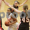 Rob Winner – rwinner@shawmedia.com<br /> <br /> DeKalb's Brittney Patrick (center) attempts to drive to the basket while being surrounded by three Maine South defenders during the fourth quarter in DeKalb, Ill., Monday, Jan. 20, 2014. Maine South defeated DeKalb, 49-39.