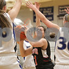 Rob Winner – rwinner@shawmedia.com<br /> <br /> Indian Creek's Alexis Van Wyhe (center) looks to shoot while surrounded by three Newark defenders in the first quarter at the Little Ten tournament in Hinckley, Ill., Thursday, January 23, 2014. Newark defeated Indian Creek, 37-23.