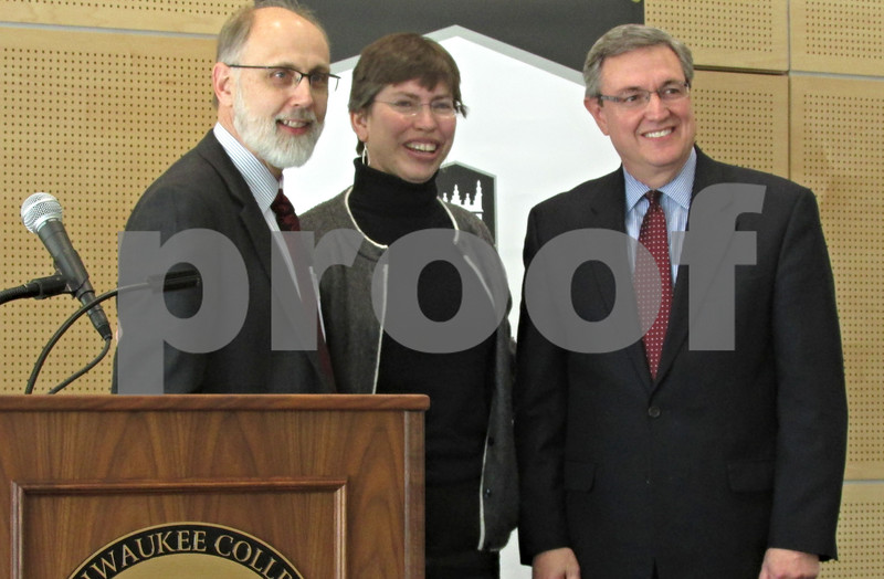 Katie Dahlstrom – kdahlstrom@shawmedia.com<br /> <br /> Northern Illinois University President Douglas Baker, Illinois Lt. Governor Sheila Simon and Kishwaukee College President Tom Choice are seen together during a press conference at Kishwaukee College in Malta on Friday afternoon. Baker and Choice officially signed a reverse transfer agreement allowing Kishwaukee students to complete their associates degrees after transferring to NIU.