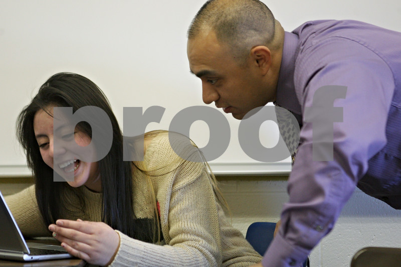 Rob Winner – rwinner@shawmedia.com<br /> <br /> Instructor Billy Hueramo helps eighth grade student Ana Hernandez at Huntley Middle School in DeKalb, Ill., Tuesday, Jan. 21, 2014. District 428 is trying to hire more minority, bilingual and male teachers.<br /> <br /> ***The second sentence is from information I received from the photo request. Please check with Katie's story to confirm this angle.***