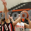 Rob Winner – rwinner@shawmedia.com<br /> <br /> DeKalb's Alexis Hammond (12) is pressured by a Maine South defender during the second quarter in DeKalb, Ill., Monday, Jan. 20, 2014. Maine South defeated DeKalb, 49-39.