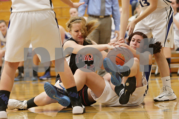 Rob Winner – rwinner@shawmedia.com<br /> <br /> Indian Creek's Emma Goodrich (left) and Newark's Kristine Zitt struggle for a ball in the second quarter at the Little Ten tournament in Hinckley, Ill., Thursday, January 23, 2014. Newark defeated Indian Creek, 37-23.