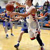 Monica Maschak - mmaschak@shawmedia.com<br /> Genoa-Kingston's Tommy Lucca passes the ball in the third quarter against Rockford Christian on Tuesday, January 21, 2014. The Cogs won, 48-35.
