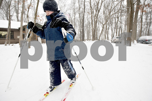 Monica Maschak - mmaschak@shawmedia.com<br /> Christopher Mamoser, 7, cross country skis at the annual Winterfest hosted by the University of Illinois Extension at the Natural Resource Education Center in Russell Woods Forest Preserve in Genoa on Saturday, January 18, 2014.