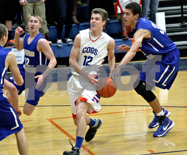 Monica Maschak - mmaschak@shawmedia.com<br /> Genoa-Kingston's Tommy Hansen approaches the hoop in the first quarter against Rockford Christian on Tuesday, January 21, 2014. The Cogs won, 48-35.