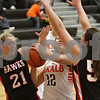 Rob Winner – rwinner@shawmedia.com<br /> <br /> DeKalb's Alexis Hammond (12) is pressured by a Maine South defenders Megan Roberts (21) and Julia Spuria (55) during the fourth quarter in DeKalb, Ill., Monday, Jan. 20, 2014. Maine South defeated DeKalb, 49-39.