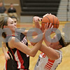 Rob Winner – rwinner@shawmedia.com<br /> <br /> Maine South's Hailey Schoneman (left) and DeKalb's Madelyn Johnson struggle for a ball under the Barbs' basket during the first quarter in DeKalb, Ill., Monday, Jan. 20, 2014. Maine South defeated DeKalb, 49-39.
