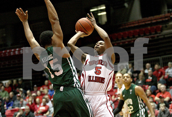 Monica Maschak - mmaschak@shawmedia.com<br /> Northern Illinois' Travon Baker attempts a field goal in the first half against Ohio University on Saturday, January 18, 2014. The Huskies lost, 65-46.