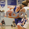 Rob Winner – rwinner@shawmedia.com<br /> <br /> Hinckley-Big Rock's Anne Klein (center) loses the ball after trying to maneuver past two Serena defenders in the second quarter at the Little Ten tournament in Hinckley, Ill., Thursday, January 23, 2014. Serena defeated H-BR, 45-29.