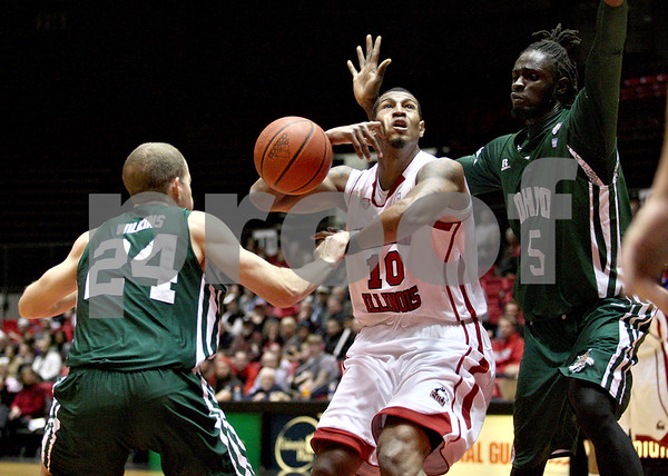 Monica Maschak - mmaschak@shawmedia.com<br /> The ball slips from the hands of Northern Illinois' Darrell Bowie in the first half against Ohio University on Saturday, January 18, 2014. The Huskies lost, 65-46.