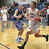 Monica Maschak - mmaschak@shawmedia.com<br /> Genoa-Kingston's Tommy Hansen prepares to shoot in the third quarter against Rockford Christian on Tuesday, January 21, 2014. The Cogs won, 48-35.