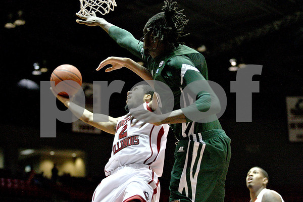 Monica Maschak - mmaschak@shawmedia.com<br /> Northern Illinois' Aaron Armstead attempts a field goal in the second half against Ohio University on Saturday, January 18, 2014. The Huskies lost, 65-46.