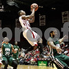 Monica Maschak - mmaschak@shawmedia.com<br /> Northern Illinois' Travon Baker gets air in the first half against Ohio University on Saturday, January 18, 2014. The Huskies lost, 65-46.