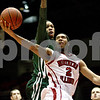 Monica Maschak - mmaschak@shawmedia.com<br /> Northern Illinois' Aaron Armstead goes for two in the first half against Ohio University on Saturday, January 18, 2014. The Huskies lost, 65-46.