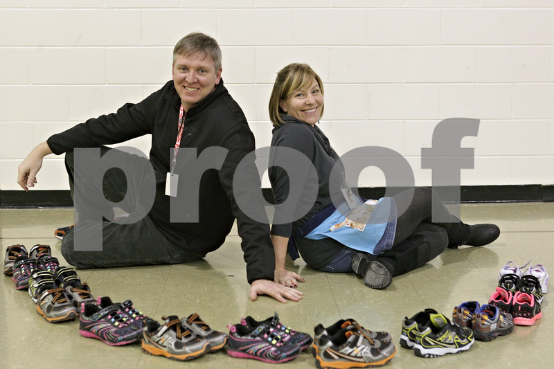 Rob Winner – rwinner@shawmedia.com<br /> <br /> Sean Sparrow and Cate Cardella, both teachers at Tyler Elementary School in DeKalb, helped raise money to buy 21 pairs of gym shoes for students by selling fake mustaches.<br /> <br /> Tuesday, Jan. 21, 2014