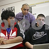 Rob Winner – rwinner@shawmedia.com<br /> <br /> Huntley Middle School teacher Billy Hueramo works with eighth-graders Alejandro Bonilla (left) and Luis Soria on Tuesday, Jan. 21, 2014. District 428 is trying to hire more minority, bilingual and male teachers.<br /> <br /> ***The second sentence is from information I received from the photo request. Please check with Katie's story to confirm this angle.***