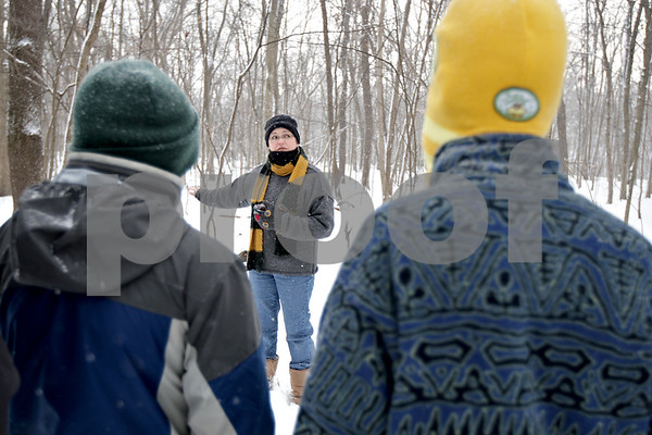Monica Maschak - mmaschak@shawmedia.com<br /> Peggy Doty leads a family hike to end the annual Winterfest hosted by the University of Illinois Extension at the Natural Resource Education Center in Russell Woods Forest Preserve in Genoa on Saturday, January 18, 2014.