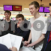 Rob Winner – rwinner@shawmedia.com<br /> <br /> DeKalb bowling coach Ernie Pinne (left) talks with his team including (from left to right) Sean Mattingly, Jack Berry, Kelan Graddy and Michael Belluzzi at the start of practice at Mardi Gras Lanes in DeKalb, Ill., Monday, Jan. 20, 2014.