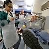 Monica Maschak - mmaschak@shawmedia.com<br /> Heartland Blood Centers Team Leader Nyisha Richardson sanitizes Bill Cummings' arm during a blood drive benefitting the Heartland Blood Centers at the First Congregational United Church of Christ on Thursday, January 23, 2014.