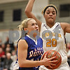 Rob Winner – rwinner@shawmedia.com<br /> <br /> Hinckley-Big Rock's Jacqueline Madden (front) goes to the basket as Serena's Ashante Witter (20) defends in the second quarter at the Little Ten tournament in Hinckley, Ill., Thursday, January 23, 2014. Serena defeated H-BR, 45-29.