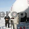 Rob Winner – rwinner@shawmedia.com<br /> <br /> Gary Metcalf of Conserv FS prepares to fill a propane tank at a DeKalb business on Monday, Jan. 27, 2014.