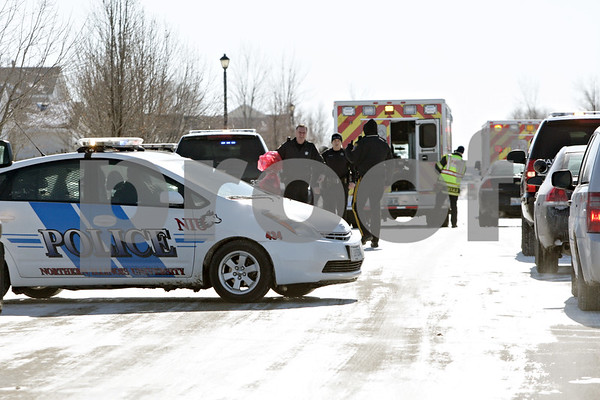Rob Winner – rwinner@shawmedia.com<br /> <br /> Emergency personnel from DeKalb and Northern Illinois University respond to the 1000 block of Quail Run in DeKalb, Ill., after a report of shots fired on Tuesday, Jan. 28, 2014.