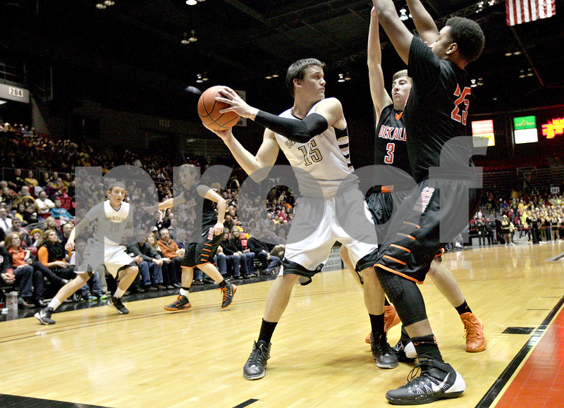 Monica Maschak - mmaschak@shawmedia.com<br /> Sycamore's Devin Mottet faces two DeKalb defenders during the first quarter of the annual DeKalb versus Sycamore basketball game at the Convocation Center on Friday, January 31, 2014.