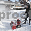 Rob Winner – rwinner@shawmedia.com<br /> <br /> DeKalb residents Chris Heinrich (right) and Kevin Montgomery clear snow from the sidewalk and driveway of an elderly neighbor on East Garden Street on Monday, Jan. 27, 2014.