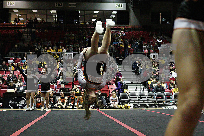 Rob Winner – rwinner@shawmedia.com<br /> <br /> A DeKalb cheerleader flips during a halftime performance at the Convocation Center in DeKalb, Ill., Friday, Jan. 31, 2014. DeKalb defeated Sycamore, 46-42.