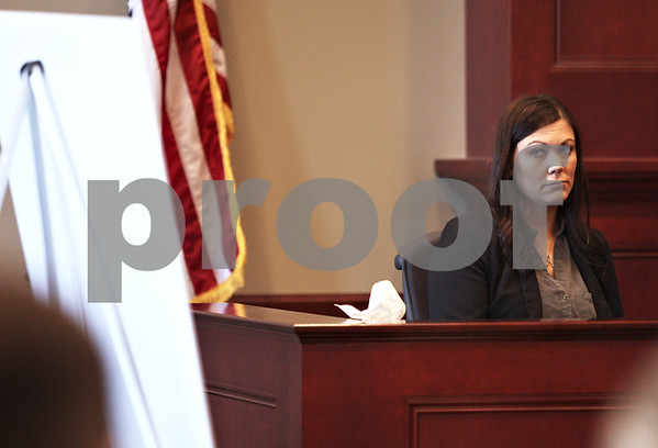Monica Maschak - mmaschak@shawmedia.com<br /> Witness Jennifer Schopfer, of Sycamore, looks to a diagram during her tesitmony during the first day of Patricia Schmidt's trial at the DeKalb County Courthouse on Tuesday, January 28, 2014. Schmidt is accused of reckless homicide and aggravated reckless driving in the Feb. 21, 2011, crash that killed two people.